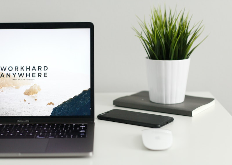 ComeThinkCreative home page header image of laptop and desk plant
